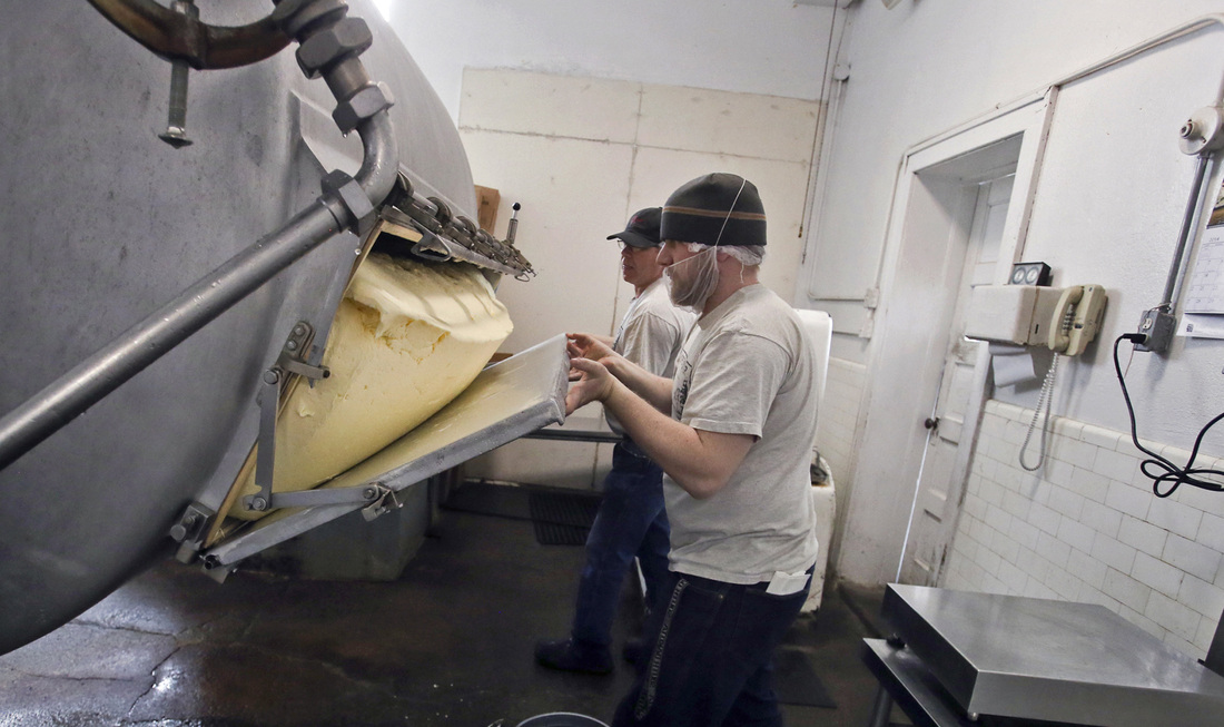 The butter masters hard at work making delicious Butter at Hope Creamery Factory in Hope MN